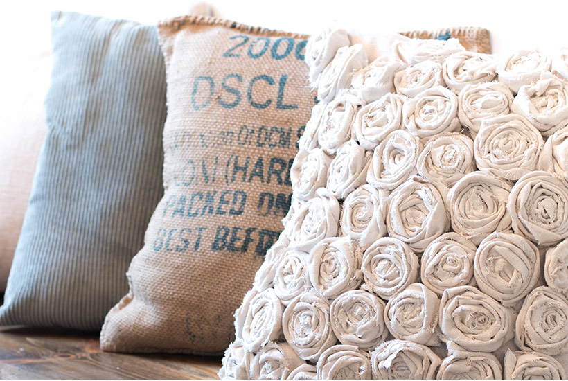Texture pillows lined up on a bench