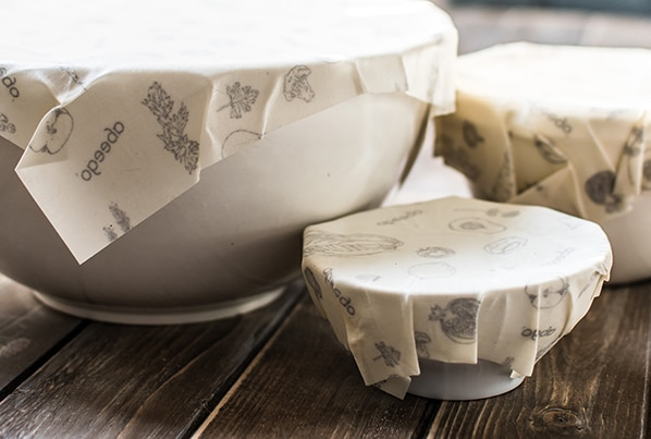 Abeego Beeswax wraps on white bowls on a wooden board