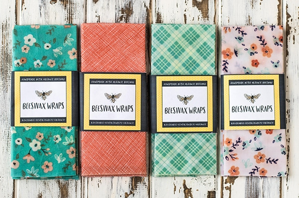 DIY beeswax wrap packages lined up on a wooden board