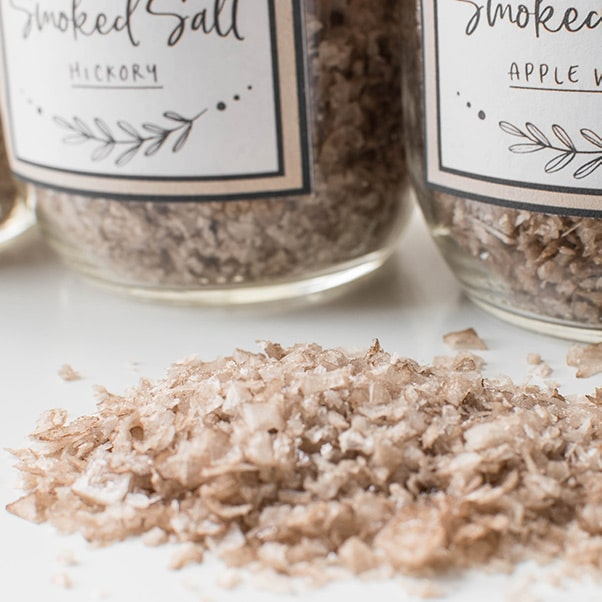 Pile of smoked salt in front of mason jars
