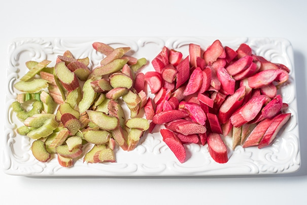 a plate of cut up rhubarb, green on the left and red on the right.